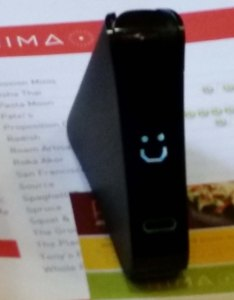 Nima gluten sensor showing gluten free response - a happy face.